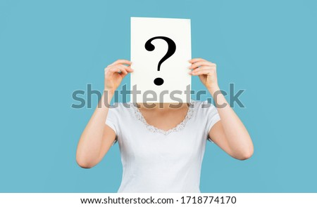 Unknown woman holding question mark. Girl holding paper question mark. Anonymous, woman question, incognita. Anonymous woman. Female incognita.Girl question, anonymous, incognita.  Foto d'archivio ©