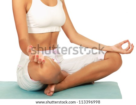 Unknown young woman meditating in a lotus position , isolated on white background