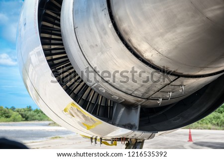 Unlatched of the fan cowling,thrust reverser and core cowling on a jet engine for maintenance before flight.Blue sky clouds.