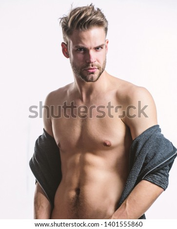 Unleashed desire. Seductive macho feeling sexy. Attractive sexy body. Confident in his attractiveness. Time change clothes. Man handsome sexy undressing. Hipster sexy muscular torso take off clothes.