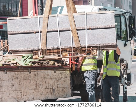 unloading concrete curbs. road works. the installation of new curbs