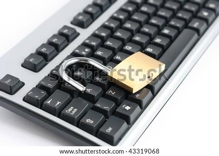 unlocked open padlock with computer keyboard