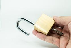 Unlocked Padlock and key on the white background
