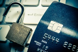 Unlocked security lock on credit cards / Credit cards data decryption and fraud concept