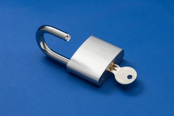 Unlocked Silver Padlock on a blue background.