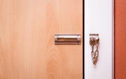 Unlocked wooden door.
