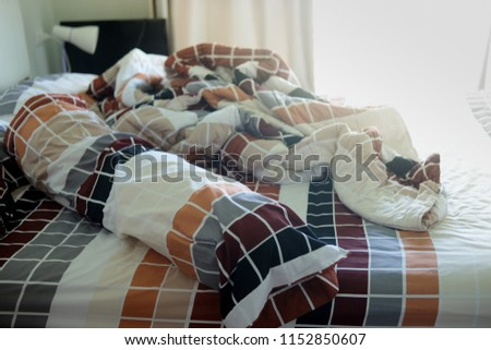 Unmade bed with crumpled bed sheet and pillows after comfort duvet sleep waking up in the morning. #1152850607
