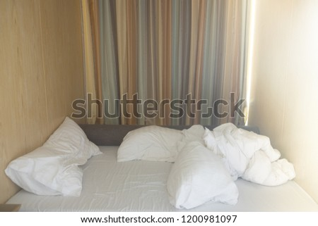 Unmade bed with crumpled bed sheet and pillows after comfort duvet sleep waking up in the morning. #1200981097