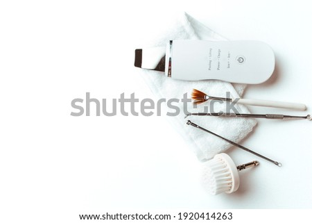uno's scrubber spoon on a white background top view .the concept of cosmetology and spa .space for text Foto stock ©