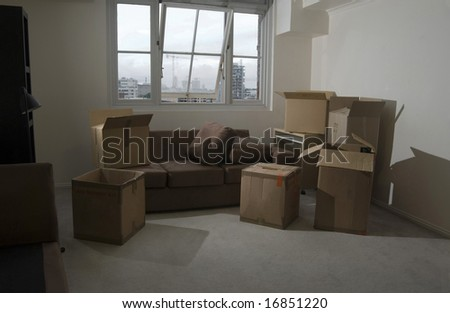 unpacking boxes after moving into a new apartment