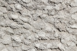 Unpainted cement wall with trowel marks patterned background