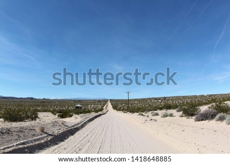 Unpaved road at desert heights in twentynine palms, southern california, usa #1418648885