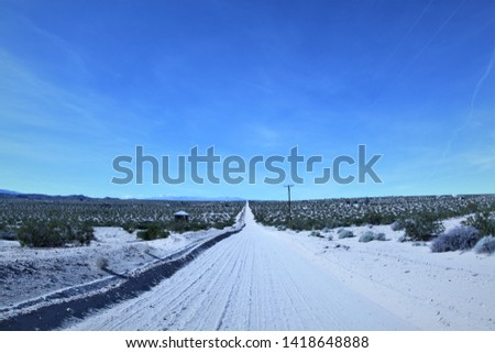 Unpaved road at desert heights in twentynine palms, southern california, usa #1418648888