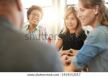 Unposed group of creative business people in an open concept office brainstorming their next project. Photo stock ©