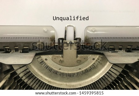 Unqualified typed words on a vintage typewriter