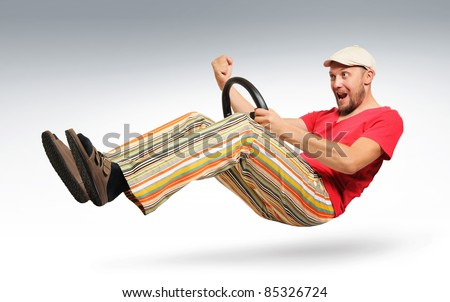 Unreal bearded man car driver in striped trousers and sandals, a cap, concept