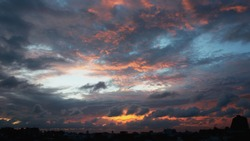 Unreal colourful sunset with various shapes of clouds.