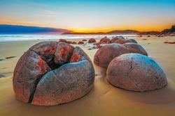 Unreal Moeraki Boulders at sunrise, Koekohe beach,Otago, South Island, New Zealand