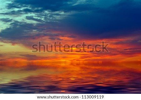 """Unreal sunset, in the form of """"fire"""" over the sea"""