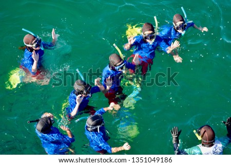Unrecognisable group of youths in snorkelling lesson activity in South Australia #1351049186