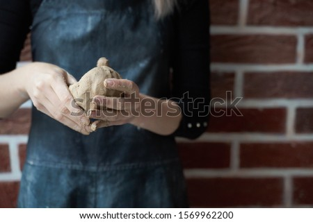 Unrecognisable woman making ceramic bowl in hand. Creative hobby concept. Earn extra money, side hustle, turning hobbies into cash, passion into a job, copy empty space #1569962200