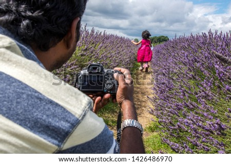 Unrecognizable Asian man taking picture of a young girl in a lavender farm