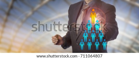 Unrecognizable blue chip recruitment manager selecting the female white collar worker icon atop a corporate pyramid of employees. Business concept for talent acquisition, equality and female quota.
