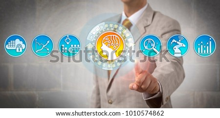 Unrecognizable businessman assigning logistics tasks to an artificial intelligence unit. Industry and technology concept for machine intelligence, self learning systems, digital pattern recognition.