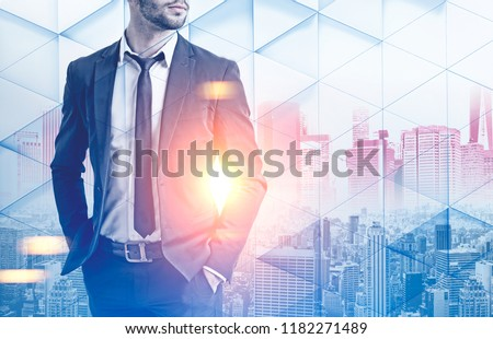Photo of Unrecognizable businessman in dark suit standing over a morning city background. Geometric pattern foreground. Toned image double exposure mock up