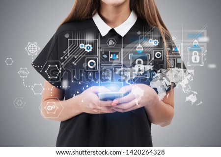 Unrecognizable businesswoman in black dress holding smartphone with double exposure of business interface and infographics. Toned image #1420264328