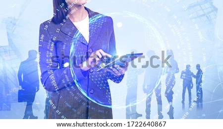 Unrecognizable businesswoman using tablet computer in city with double exposure of her team and online business interface. Concept of work during covid 19 coronavirus pandemic. Toned image