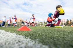unrecognizable children's rugby tournament, unfocused view