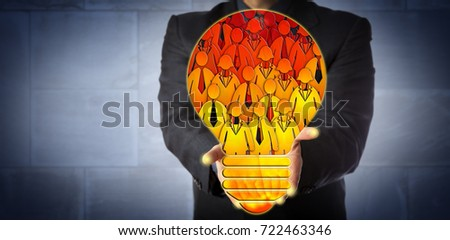 Unrecognizable corporate manager offering a virtual talent pool shaped like a light bulb filled with employee icons. HR concept for team building, teamwork, staffing solution and skilled workforce.