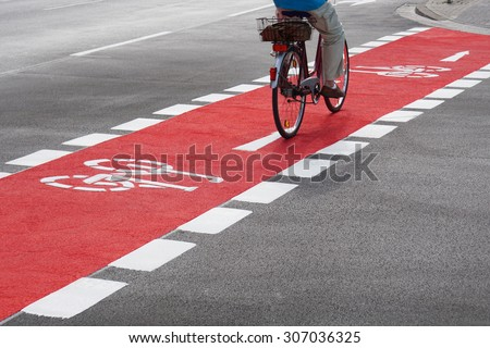 unrecognizable cyclist cycling...