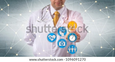 Unrecognizable doctor activating predictive analytics in network. Healthcare IT concept for deep learning, real-time reporting, patient data analytics, improvement of population health, EHR system.