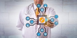 Unrecognizable doctor of medicine activates a healthcare logistics blockchain app. Health care IT concept for data management via distributed virtual public ledger technology for medical records.