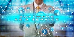 Unrecognizable enterprise manager operating a SOFTWARE AS A SERVICE application via computer network. IT concept for SaaS, multitenant architecture, horizontal scaling, scalability and multitenancy.