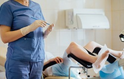 Unrecognizable female doctor gynecologist working with patient. Vaginal Smear.