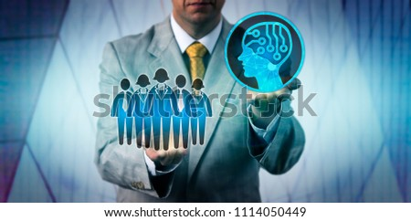 Unrecognizable male business manager raising artificial intelligence above a work team. Technology concept for AI, machine and deep learning, robolution, digital transformation of the workforce.