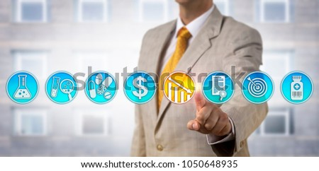 Unrecognizable male pharmaceutical business manager is lowering drug price via touch screen interface. Pharma industry marketing concept for competitive pricing strategy for newly approved drugs. #1050648935