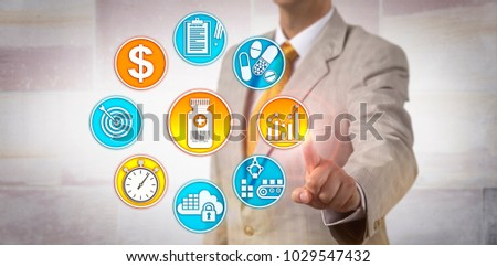 Unrecognizable male pharmaceutical manufacturing executive setting a price strategy for a therapeutic product. Concept for value based pricing, value based payment and near real time data capture.