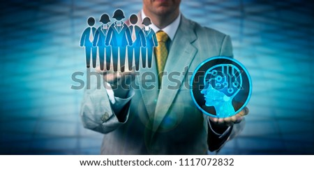 Unrecognizable male recruitment agent raising a white collar team of knowledge workers above an artificial intelligence system. Human resources and technology concept for AI augmenting team work.