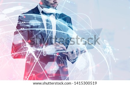 Unrecognizable man in suit standing with laptop with double exposure of globe and flying planes hologram. Concept of international transportation and logistics. Toned image stock photo