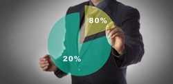 Unrecognizable manager with marker in hand approaching virtual pie chart illustrating the Pareto principle. Business concept for 80 - 20 rule, law of the vital few and principle of factor sparsity.