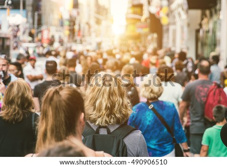 Unrecognizable mass of people walking in the city #490906510