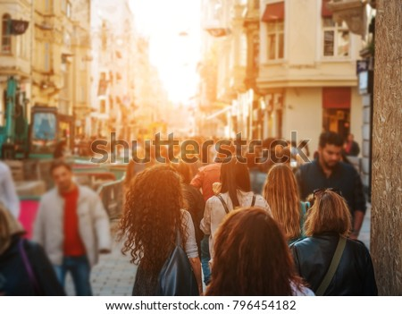 Shutterstock Unrecognizable mass of people walking in the street of the city