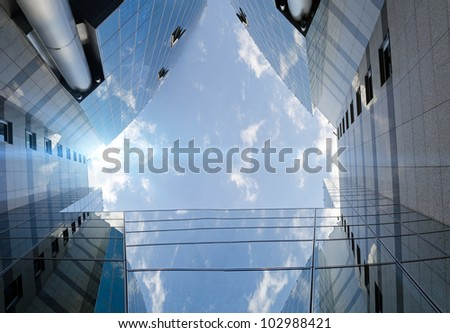 unrecognizable modern skyscraper and sky as the futuristic backdrop