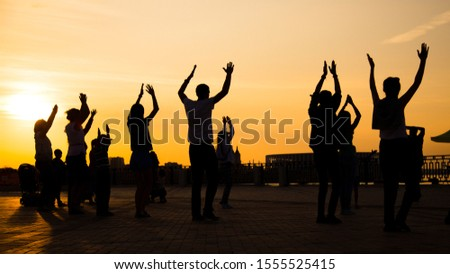 Unrecognizable people silhouette dancing on city festival at sunset. Street dance, holiday, summer and urban culture concept #1555525415