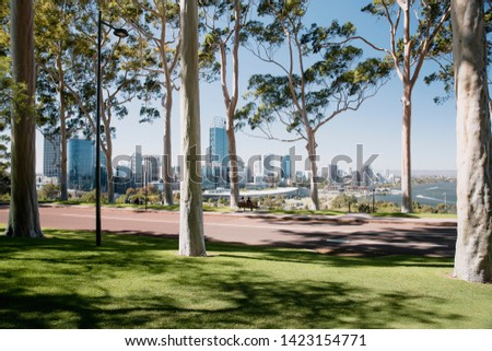 Unrecognizable people sitting on a bench in Kings Park, Peth, enjoying the view of the cities skyline on a sunny day.  #1423154771