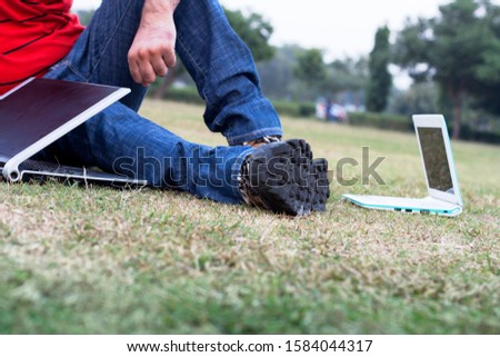 Unrecognizable person Sitting in the Park After Working on Laptop. #1584044317